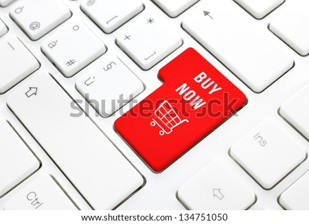 Shop online buy now business concept, Red shopping cart button or key on white keyboard photography. - stock photo