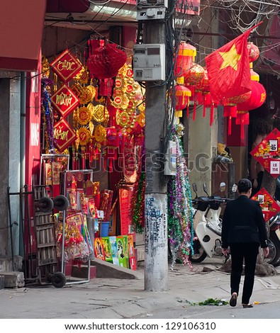 Shop sell TET decorations in Hanoi, Vietnam. Vietnamese prefer red decorations in the new year to pray for good luck. - stock photo