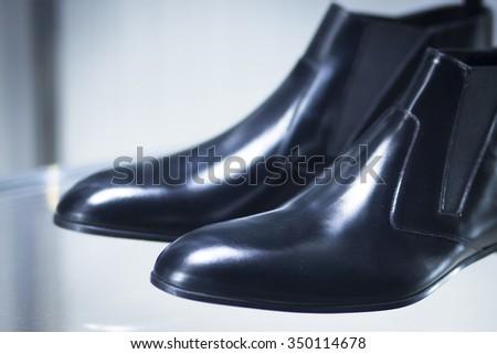 Shop window fashion store designer luxury leather shiny polished shoes. - stock photo