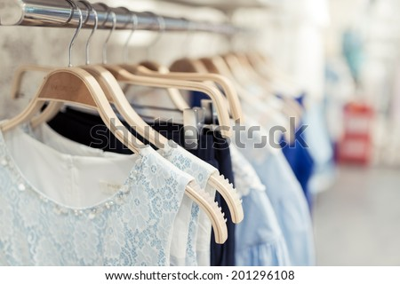 Shop with different clothes shopping, racks and shelves - stock photo