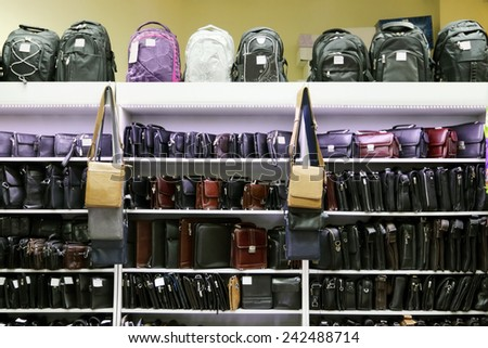 Shop with shelves with many various fashionable men bags and backpacks - stock photo