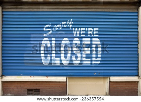 Shop with the blinds down and the sign, sorry we are closed - stock photo
