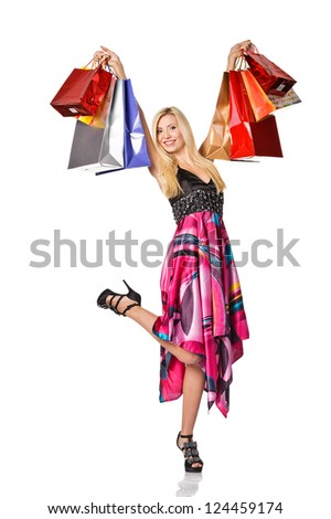 Shopaholic. picture of lovely woman with shopping bags. Isolated - stock photo
