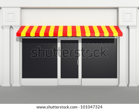 Shopfront - classic store front with colored awnings - stock photo