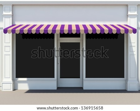 Shopfront in the sun - classic store front with mauve awnings - stock photo
