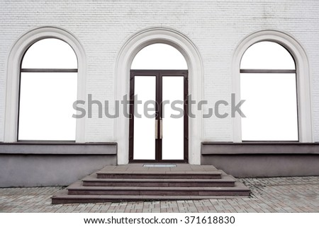 Shopfront with large windows in old building - stock photo