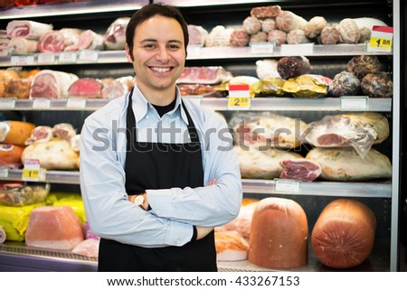 Shopkeeper at work in his grocery store