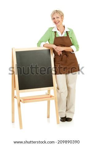Shopkeeper: Woman Stands By Blank Chalkboard - stock photo