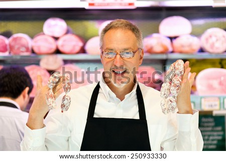 Shopkeeper working in his grocery store - stock photo