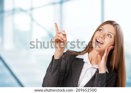 Shopper. Excited woman showing above on sale text in bubble isolated on white background - stock photo