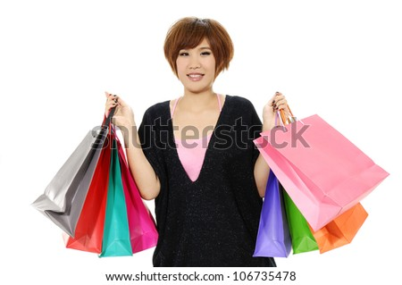 Shopper woman holding shopping bags standing happy smiling and excited in full body isolated on white background.. - stock photo