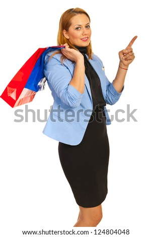 Shopper woman pointing to copy space isolated on white background - stock photo