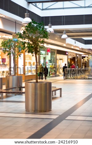 Shoppers at shopping center. Interior of a shopping mall - stock photo