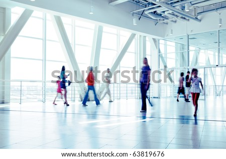 Shoppers at shopping center, motion blur. Tint blue - stock photo