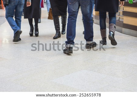 Shoppers passing by in the modern shopping mall