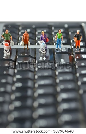 Shoppers  race with shopping cart on a computer keyboard - stock photo