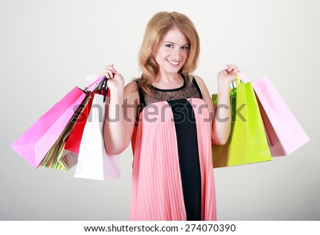 Shopping adult woman happy smiling holding shopping bags - stock photo
