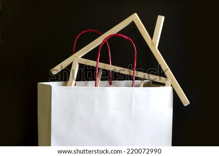 Shopping and buying a house concept in paper bag - stock photo