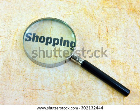 Shopping and magnifying glass  - stock photo