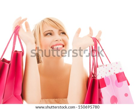 shopping and sales concept - happy woman with many shopping bags - stock photo