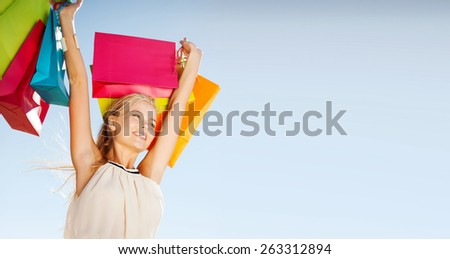 shopping and tourism concept - woman with shopping bags - stock photo