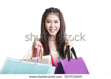 Shopping asian woman holding bags, isolated on white studio background - stock photo