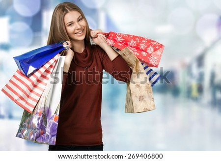 Shopping. Attractive brunette is shopping - stock photo