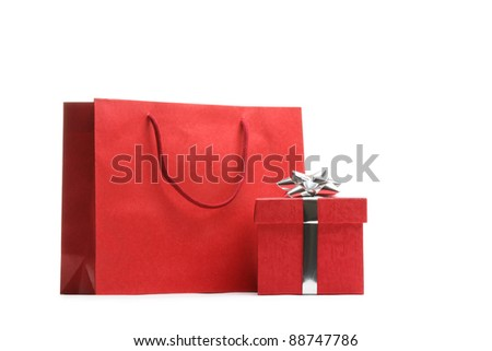 Shopping bag and gift box isolated on white. - stock photo