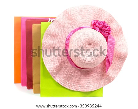 shopping bag colored  brightly and Beach Hat on  white background.