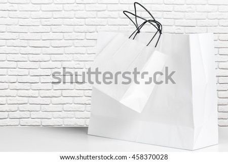 Shopping Bag of presents on white table. - stock photo