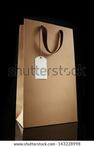 Shopping bag on black background.  brown Shopping bag.  - stock photo