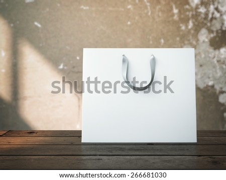 Shopping bag on wooden table - stock photo