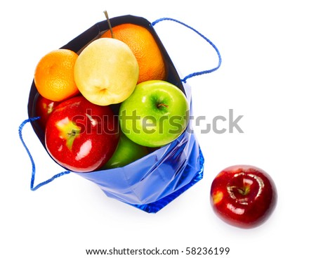 Shopping bag with fruits over white - stock photo