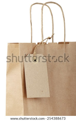 Shopping bag with tag isolated on white background. Close-up.