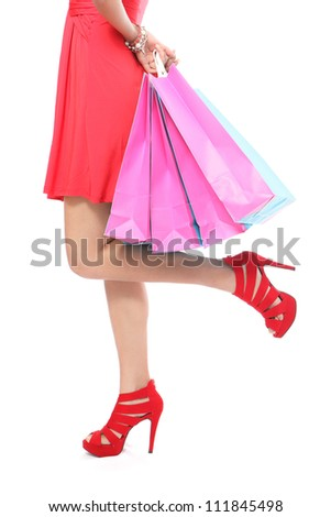 Shopping bag woman - shopper concept. Closeup of woman legs and shopping bags- Isolated on white background. - stock photo