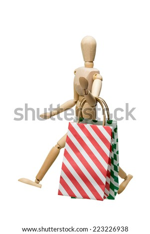 Shopping bags being carried by a mannequin, isolated on white. - stock photo