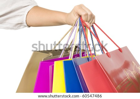 shopping bags in hand isolated on white