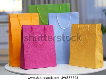 Shopping bags of different colours in the room