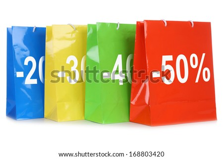 Shopping bags with discounts during sale, isolated on a white background - stock photo