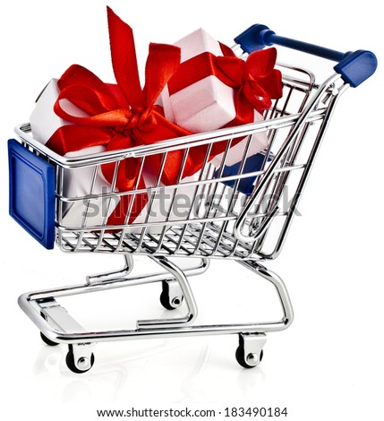 Shopping basket cart with gift boxes - isolated on white background - stock photo