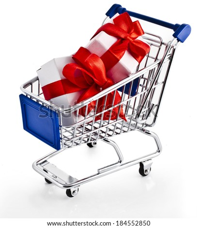 Shopping basket cart with holyday gift boxes - isolated on white background - stock photo