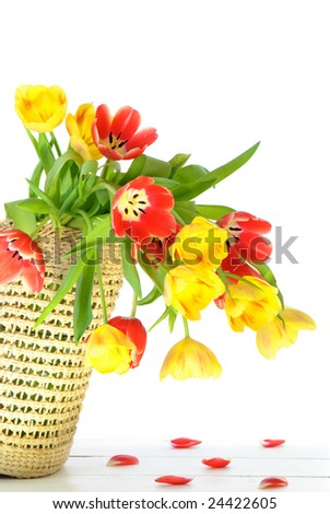 Shopping basket full of red and yellow tulip flowers - stock photo