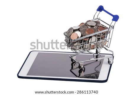 Shopping basket full of US coins on a tablet pc isolated on a white background - stock photo