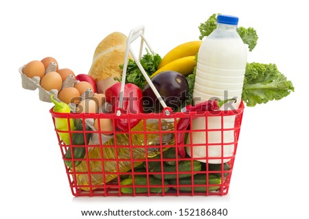 Shopping basket with groceries, isolated over white background - stock photo