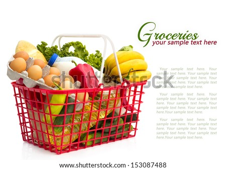 Shopping basket with groceries	, isolated over white background - stock photo