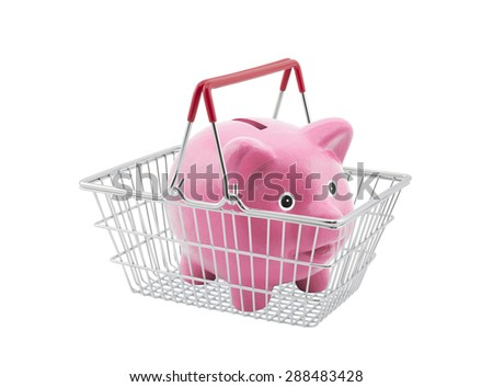 Shopping basket with piggy bank on white background - stock photo
