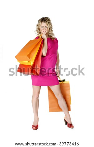 Shopping. Beautiful woman with colour packages on a white background. - stock photo