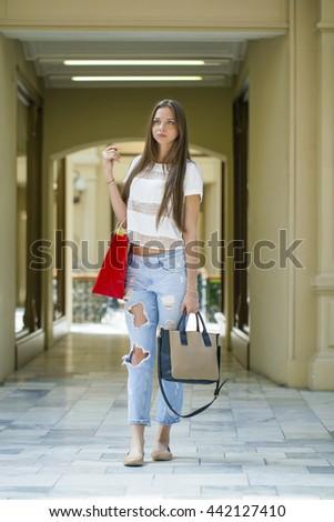 Shopping. Beautiful young brunette woman in the shop - stock photo