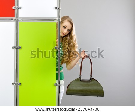 Shopping. Beautiful young woman  with handbags standing at the color screen. - stock photo