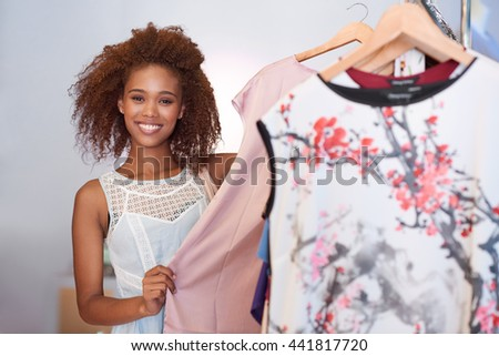 Shopping brings a smile to her face - stock photo